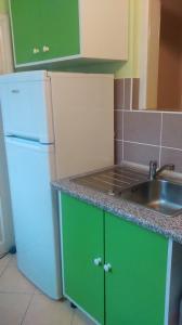 A kitchen or kitchenette at Regina Vendégház Miskolc