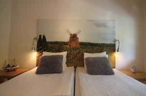 Säng eller sängar i ett rum på Snäck Annex
