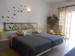 Cama o camas de una habitación en Dona Ana Garden