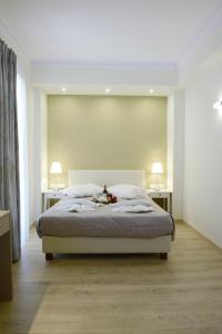 A bed or beds in a room at Phidias Hotel