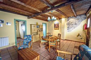 Un restaurante o sitio para comer en Casa Magosto