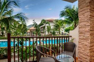 The swimming pool at or near Whispering Palms Suite