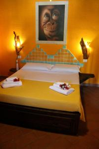 A bed or beds in a room at La Fattoria Delle Tartarughe