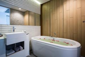 A bathroom at Asira Boutique HuaHin