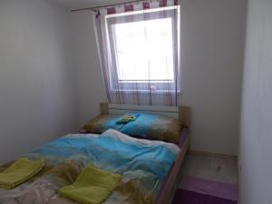 Posteľ alebo postele v izbe v ubytovaní Apartment Vihorlat