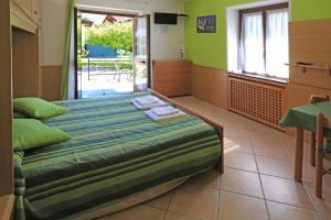 Un ou plusieurs lits dans un hébergement de l'établissement North Wind Camping & Apartment