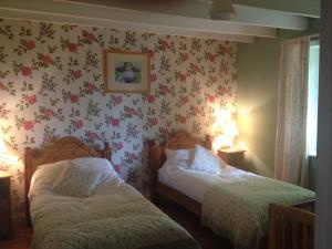 A bed or beds in a room at Barcloy Milk House