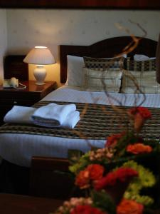 A bed or beds in a room at Ramnee Hotel