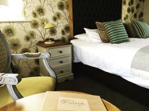 A bed or beds in a room at The Falcon Inn