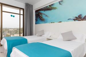 A bed or beds in a room at Blue Sea Arenal Tower - Adults Only
