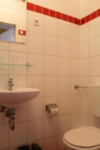 Ein Badezimmer in der Unterkunft City Pension Berlin
