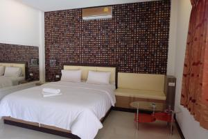 A bed or beds in a room at SC Resort Hat Yai