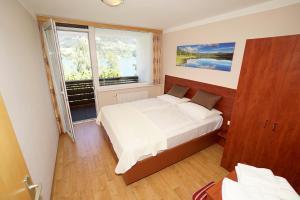 Ein Bett oder Betten in einem Zimmer der Unterkunft Appartement Alpensee