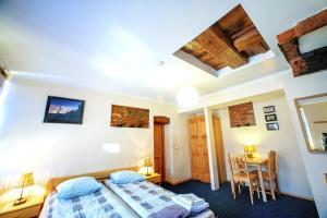 Кровать или кровати в номере Litinterp Klaipeda Guest House
