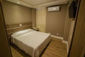 A bed or beds in a room at San Juan Royal