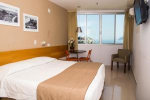 Un ou plusieurs lits dans un hébergement de l'établissement Atlantis Copacabana Hotel