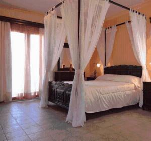 Letto o letti in una camera di Villa Dei Sogni