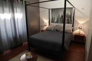 A bed or beds in a room at Atmos Luxe Navigli