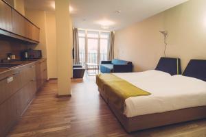 Een kamer bij Amberton Green Apartments Palanga