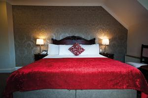 A bed or beds in a room at Killarney Riverside Hotel