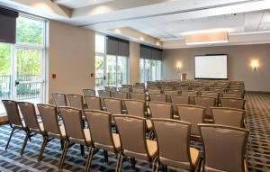 The business area and/or conference room at TownePlace Suites Orlando at FLAMINGO CROSSINGS® Town Center/Western Entrance