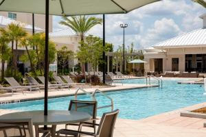 A patio or other outdoor area at TownePlace Suites Orlando at FLAMINGO CROSSINGS® Town Center/Western Entrance