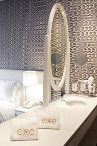 A bathroom at Exe Bacata 95