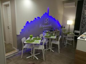 A restaurant or other place to eat at Frammenti
