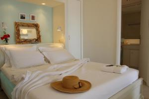A bed or beds in a room at Kavos Boutique Hotel Naxos