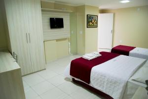 Um quarto em Reis Palace Hotel