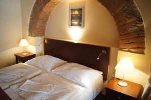 Кровать или кровати в номере Pension Harmonie