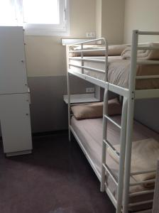 A bunk bed or bunk beds in a room at Albergue As Eiras