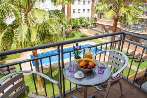 A balcony or terrace at Velor Apartamentos Turísticos