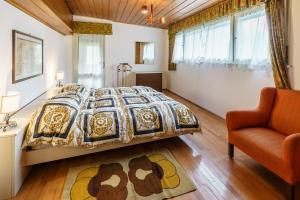 A bed or beds in a room at Villa Ca Bonel - Stayincortina