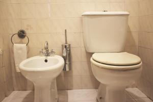 A bathroom at AL Center Aveiro - Alojamento Local