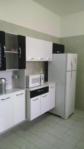 A cozinha ou cozinha compacta de Hostel 3MD