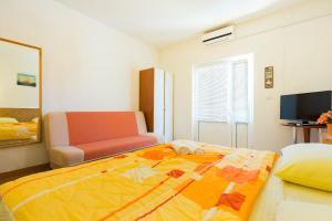 Un ou plusieurs lits dans un hébergement de l'établissement Studios Tonina
