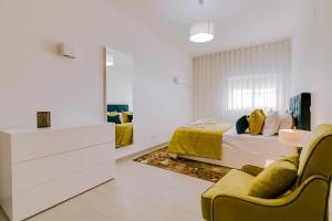 Um quarto em Apartamentos Sol & Ria