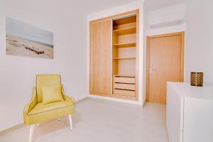 Uma área de estar em Apartamentos Sol & Ria
