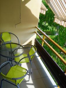 A patio or other outdoor area at Kosztolányi Apartmanház