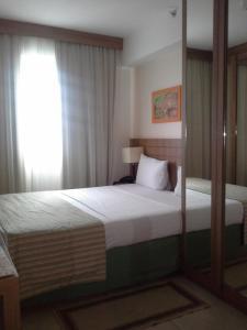 Cama ou camas em um quarto em Flat no Coraçao de Brasilia