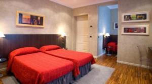 Un ou plusieurs lits dans un hébergement de l'établissement Century Hotel