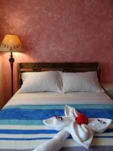 Ein Bett oder Betten in einem Zimmer der Unterkunft Arte Hostal