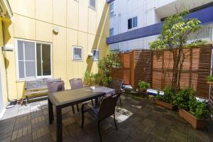 A patio or other outdoor area at K's House Kyoto -Travelers Hostel