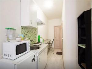 Кухня или мини-кухня в Resthouse Myakinino