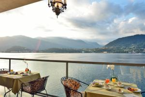 A restaurant or other place to eat at Grand Hotel Cadenabbia