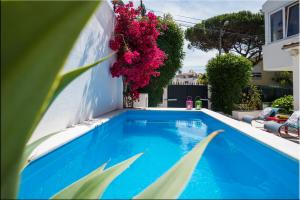 The swimming pool at or near Cascais House