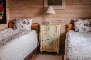 A bed or beds in a room at Västriku Holiday Home