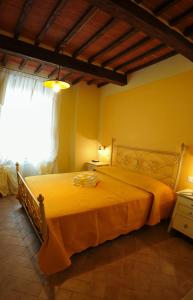A bed or beds in a room at Bed & Breakfast Viziottavo
