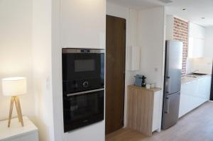 A kitchen or kitchenette at Appartement Design Scandinave - Vue sur Mer